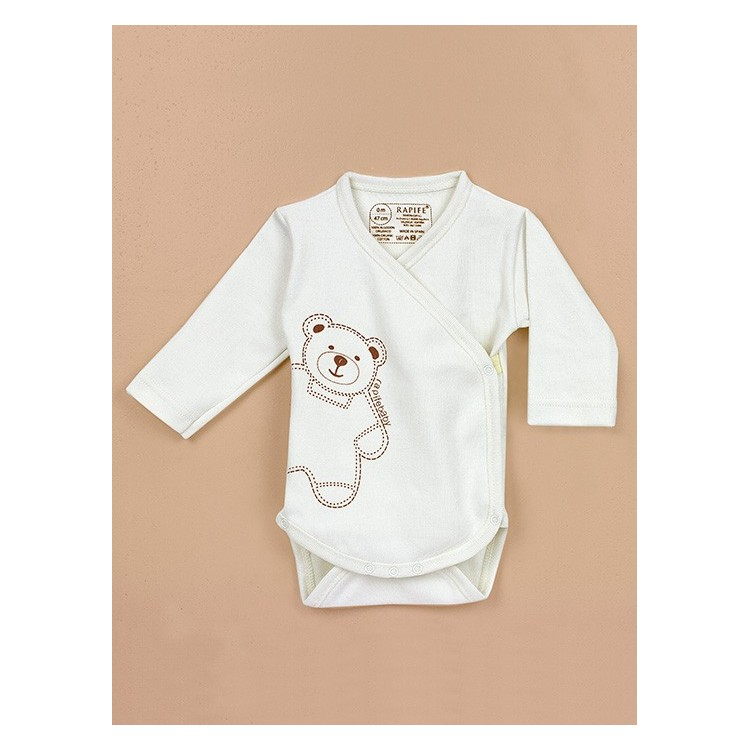 Newborn´s crossed one-piece in organic cotton.